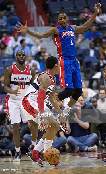 Detroit Pistons point guard Brandon Knight flies through the air past Washington Wizards shooting guard Bradley Beal during the first half of their...