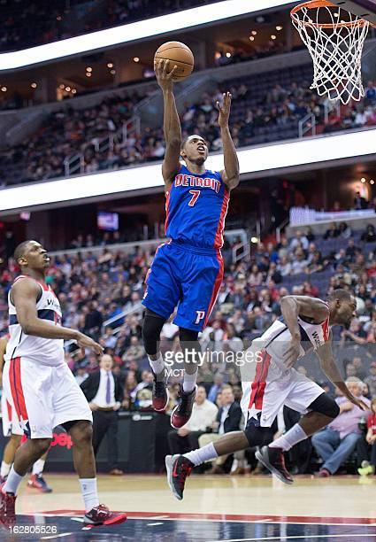 Detroit Pistons point guard Brandon Knight scores after going between Washington Wizards power forward Kevin Seraphin left and small forward Martell...