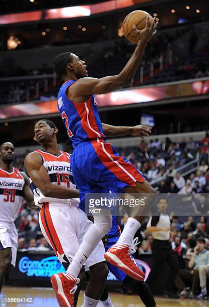 Detroit Pistons point guard Brandon Knight takes the ball to the hoop past Washington Wizards shooting guard Jordan Crawford in the first quarter at...
