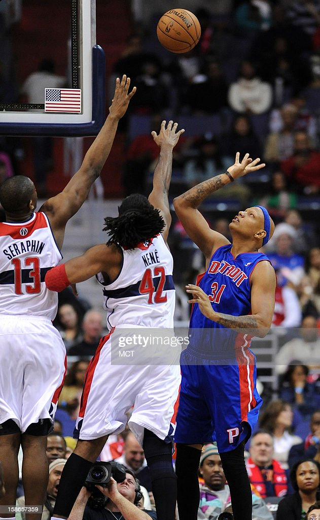 Detroit Pistons power forward Charlie Villanueva (31) lofts up a score over Washington Wizards power forward Kevin Seraphin (13) and Wizards center Nene (42) in the fourth quarter at the Verizon Center in Washington, D.C., Saturday, December 22, 2012. The Pistons defeated the Wizards, 96-87.