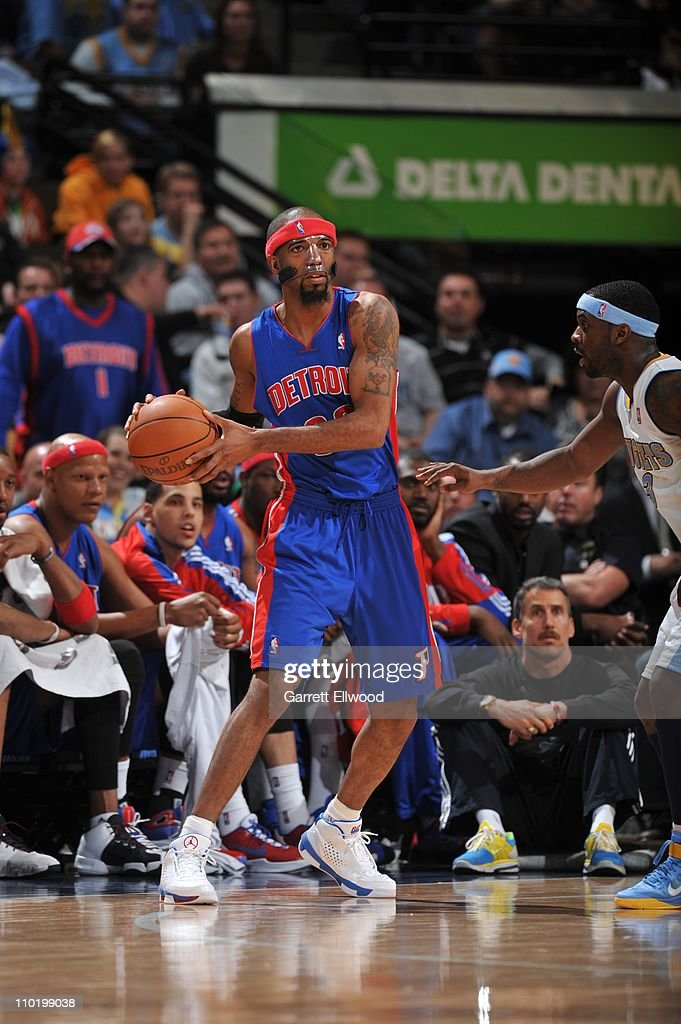 Detroit Pistons shooting guard <a gi-track='captionPersonalityLinkClicked' href=/galleries/search?phrase=Richard+Hamilton+-+Basketball+Player&family=editorial&specificpeople=201498 ng-click='$event.stopPropagation()'>Richard Hamilton</a> #32 protects the ball during the game against the Denver Nuggets on March 12, 2011 at the Pepsi Center in Denver, Colorado. The Nuggets won 131-101.