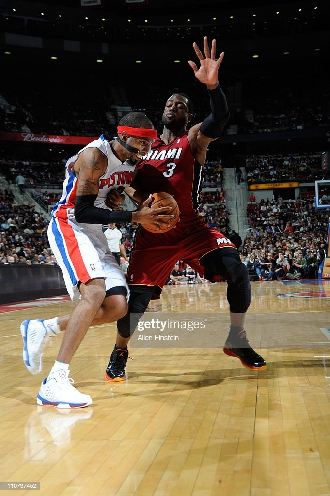 Detroit Pistons shooting guard <a gi-track='captionPersonalityLinkClicked' href=/galleries/search?phrase=Richard+Hamilton+-+Basketball+Player&family=editorial&specificpeople=201498 ng-click='$event.stopPropagation()'>Richard Hamilton</a> #32 protects the ball the ball from Miami Heat shooting guard <a gi-track='captionPersonalityLinkClicked' href=/galleries/search?phrase=Dwyane+Wade&family=editorial&specificpeople=201481 ng-click='$event.stopPropagation()'>Dwyane Wade</a> #3 during a game on March 23, 2011 at The Palace of Auburn Hills in Auburn Hills, Michigan. The Heat won 100-94.