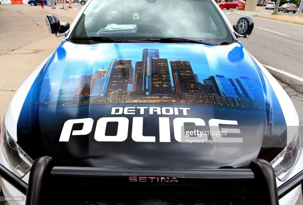 A Detroit police car sits on a downtown street on July 18, 2014 in Detroit, Michigan.