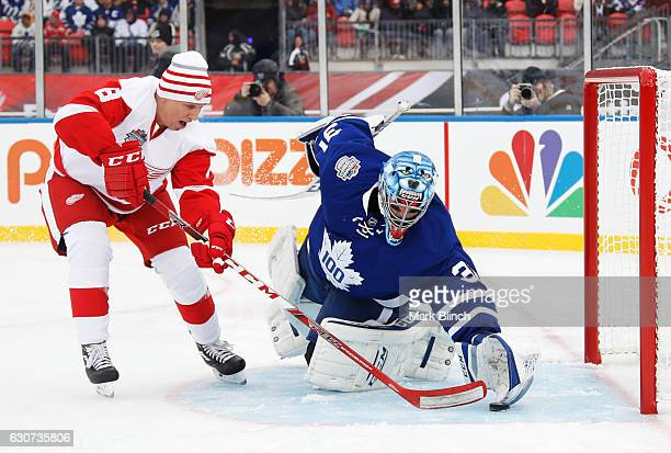 Detroit Red Wings alumni Igor Larionov scores on Toronto Maple Leafs alumni Curtis Joseph during the 2017 Rogers NHL Centennial Classic between the...