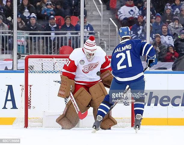 Detroit Red Wings alumni Kevin Hodson makes a save off a penalty shot from Toronto Maple Leafs alumni Borje Salming during the 2017 Rogers NHL...