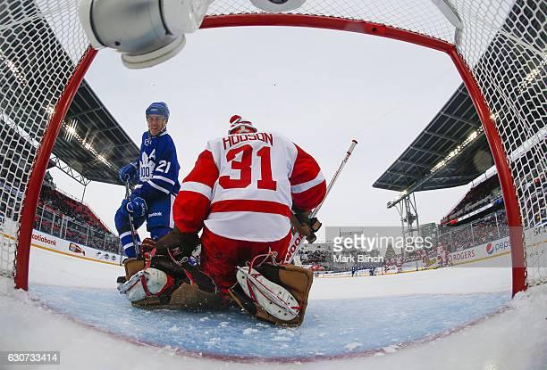 Detroit Red Wings alumni Kevin Hodson makes a save on Toronto Maple Leafs alumni Borje Salming at the 2017 Rogers NHL Centennial Classic Alumni game...