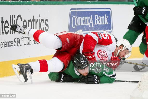 Detroit Red Wings Defenceman Mike Green falls on top of Dallas Stars Center Radek Faksa during the NHL game between the Detroit Red Wings and Dallas...