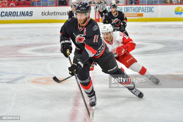 Detroit Red Wings Defenceman Robbie Russo defends against Carolina Hurricanes Center Jordan Staal in a game between the Detroit Red Wings and the...