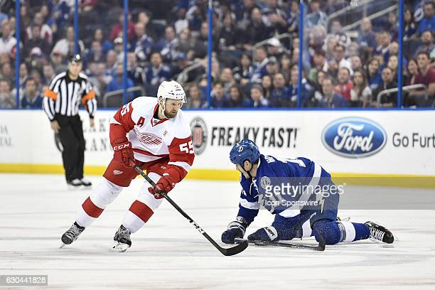 Detroit Red Wings defender Niklas Kronwall can't skate by Tampa Bay Lightning center Brian Boyle during an NHL hockey game between the Detroit Red...