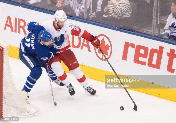 Detroit Red Wings defenseman Mike Green battles for a puck with Toronto Maple Leafs center Zach Hyman during the second period in a game at Air...