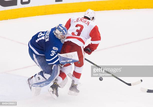 Detroit Red Wings defenseman Nick Jensen collides with Toronto Maple Leafs goalie Frederik Andersen during the second period in a game at Air Canada...