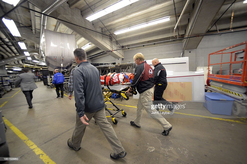 Detroit Red Wings defenseman Niklas Kronwall (55) is carted off the ice on a stretcher after a hit by Colorado Avalanche left wing Cody McLeod (55) along the boards in the first period October 17, 2013 at Pepsi Center. McLeod was called for boarding on the play.