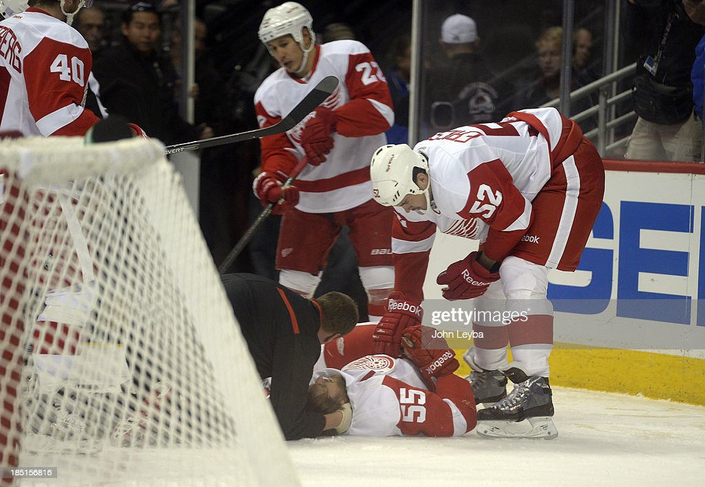 Detroit Red Wings defenseman Niklas Kronwall (55) is looked at by trainers after a hit up against the boards during the first period by Colorado Avalanche left wing Cody McLeod (55) October 17, 2013 at Pepsi Center. Niklas Kronwall was taken off the ice by stretcher.