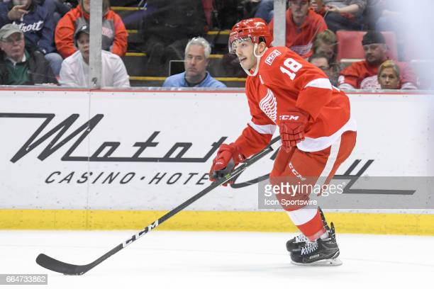 Detroit Red Wings defenseman Robbie Russo rushes up ice with the puck during the NHL hockey game between the Ottawa Senators and Detroit Red Wings on...