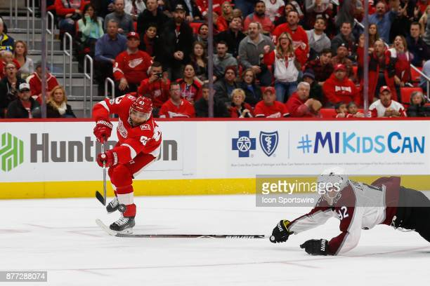 Detroit Red Wings defenseman Trevor Daley attempts a shot that is deflected by Colorado Avalanche forward Gabriel Landeskog of Sweden during a...