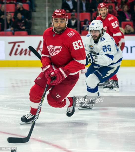 Detroit Red Wings defenseman Trevor Daley skates with the puck followed by Tampa Bay Lightning forward Nikita Kucherov in the second period of the...