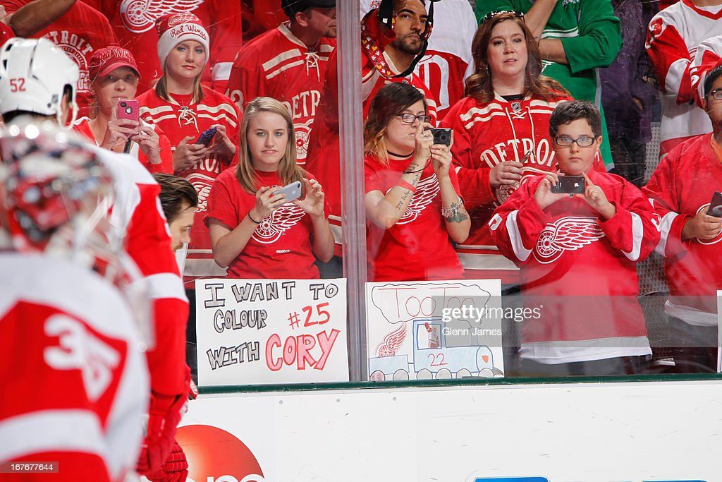 Detroit Red Wings fans cheer on their team on the road against the Dallas Stars at the American Airlines Center on April 27, 2013 in Dallas, Texas.