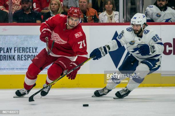 Detroit Red Wings forward Dylan Larkin tries to get to the puck controlled by Tampa Bay Lightning forward Nikita Kucherov in the third period of the...