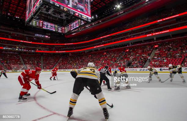 Detroit Red Wings forward Dylan Larkin watches from the outside of a face off circle in the first period of the Boston Bruins at Detroit Red Wings...