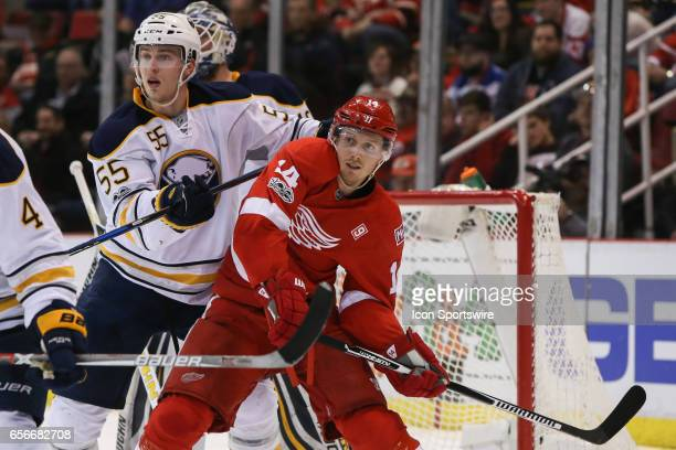 Detroit Red Wings forward Gustav Nyquist of Sweden battles against Buffalo Sabres defenseman Rasmus Ristolainen of Finland for position in front of...