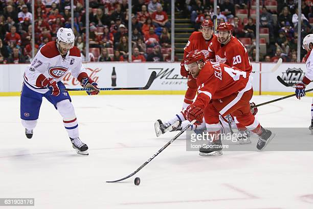 Detroit Red Wings forward Luke Glendening and Montreal Canadiens forward Max Pacioretty chase after the puck during the second period of a regular...
