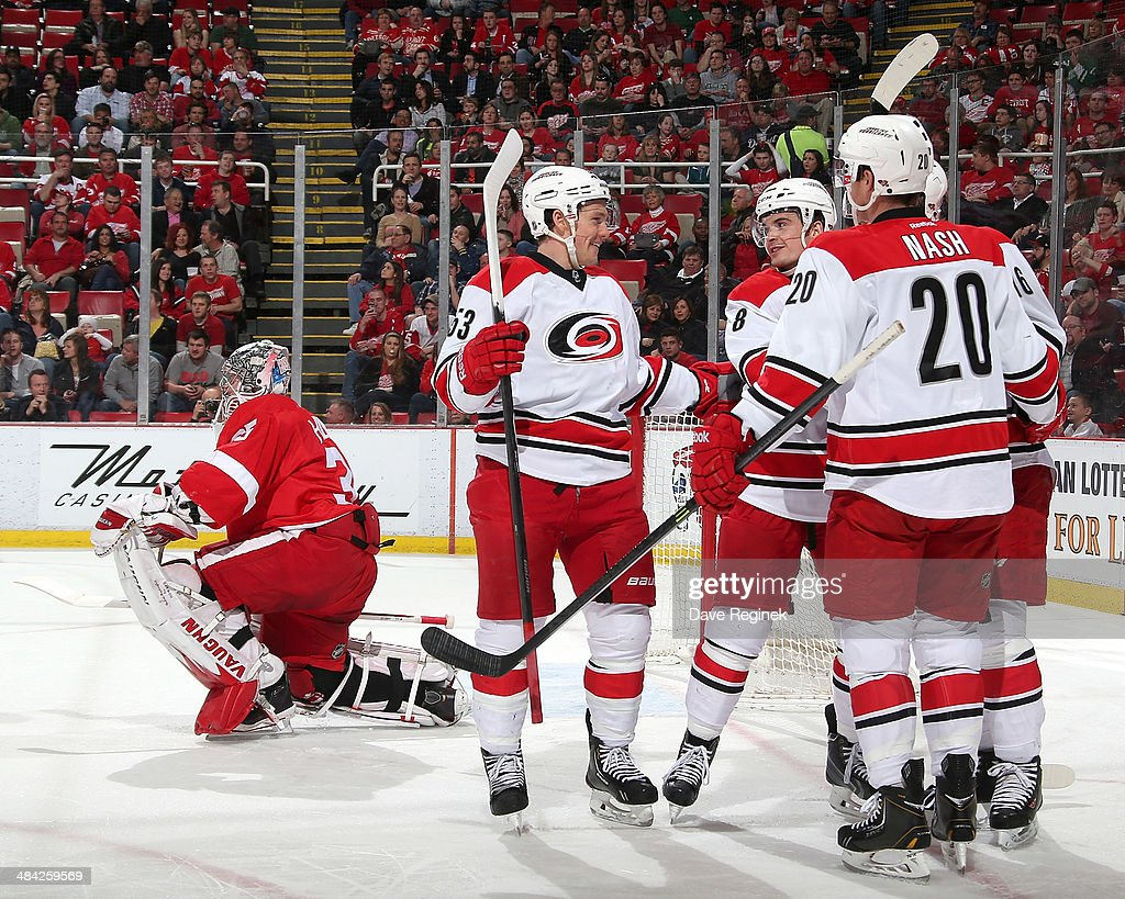 Detroit Red Wings goalie <a gi-track='captionPersonalityLinkClicked' href=/galleries/search?phrase=Jimmy+Howard&family=editorial&specificpeople=2118637 ng-click='$event.stopPropagation()'>Jimmy Howard</a> #35 gets up off the ice as Carolina Hurricanes left wing <a gi-track='captionPersonalityLinkClicked' href=/galleries/search?phrase=Jeff+Skinner&family=editorial&specificpeople=3147596 ng-click='$event.stopPropagation()'>Jeff Skinner</a> #53, center <a gi-track='captionPersonalityLinkClicked' href=/galleries/search?phrase=Riley+Nash&family=editorial&specificpeople=4324981 ng-click='$event.stopPropagation()'>Riley Nash</a> #20 and center <a gi-track='captionPersonalityLinkClicked' href=/galleries/search?phrase=Andrei+Loktionov&family=editorial&specificpeople=5370946 ng-click='$event.stopPropagation()'>Andrei Loktionov</a> #8 congratulate teammate <a gi-track='captionPersonalityLinkClicked' href=/galleries/search?phrase=Elias+Lindholm&family=editorial&specificpeople=8613151 ng-click='$event.stopPropagation()'>Elias Lindholm</a> #16 after scoring a goal during an NHL game on April 11, 2014 at Joe Louis Arena in Detroit, Michigan.