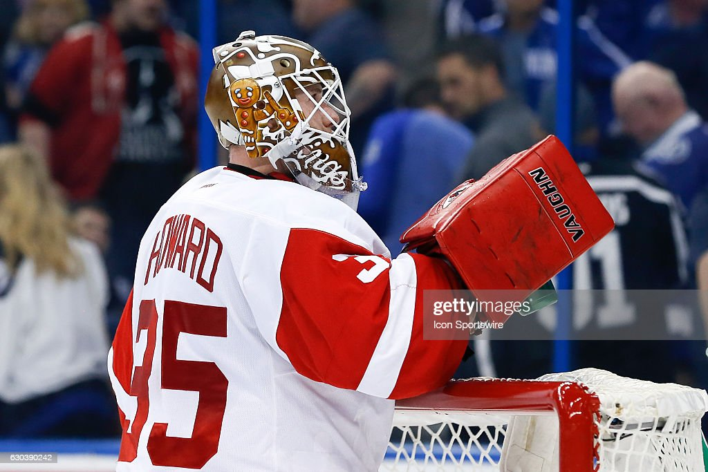 Detroit Red Wings goalie Jimmy Howard (35) wears a holiday gingerbread themed goalie mask during the NHL game between the Detroit Red Wings and the Tampa Bay Lightning on December 20, 2016, at Amalie Arena in Tampa Florida.