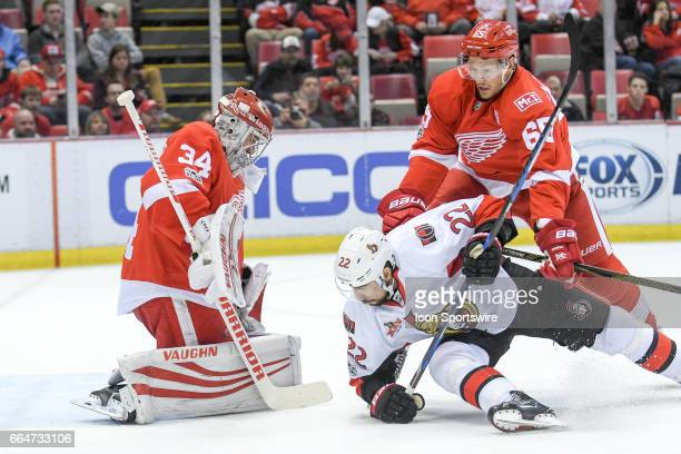 Detroit Red Wings goalie Petr Mrazek makes this save as Detroit Red Wings defenseman Danny DeKeyser checks Ottawa Senators center Chris Kelly during...