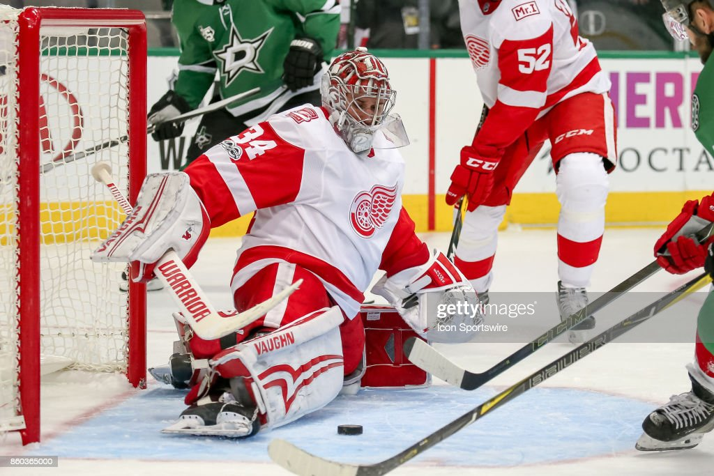 Detroit Red Wings Goalie Petr Mrazek (34) stretches to make a pad save during the NHL game between the Detroit Red Wings and Dallas Stars on October 10, 2017 at the American Airlines Center in Dallas, TX.