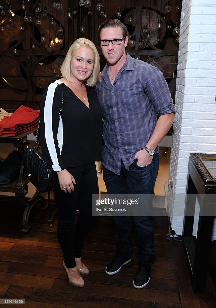 Detroit Red Wings goaltender <a gi-track='captionPersonalityLinkClicked' href=/galleries/search?phrase=Jimmy+Howard&family=editorial&specificpeople=2118637 ng-click='$event.stopPropagation()'>Jimmy Howard</a> (R) and his wife attend John Varvatos event as part of 2013 NHL/NHLPA Player Media Tour on September 4, 2013 in New York City.