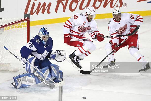 TORONTO ON JANUARY 1 Detroit Red Wings left wing Henrik Zetterberg leaps out of the way of a shot on Frederik Andersen as Thomas Vanek watches as the...