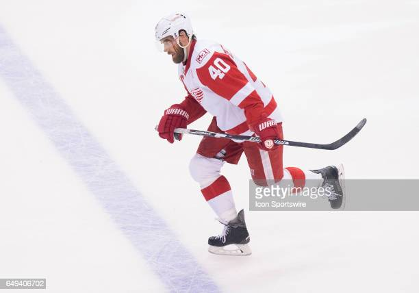 Detroit Red Wings left wing Henrik Zetterberg skates to the bench with a cut on his face during the third period in a game against the Toronto Maple...