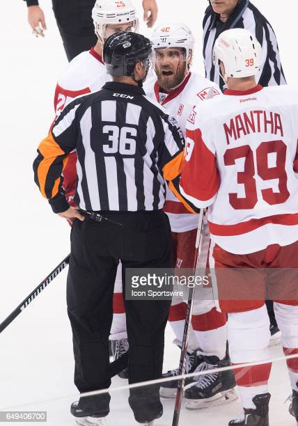 Detroit Red Wings left wing Henrik Zetterberg talks with NHL referee Dean Morton during the third period in a game against the Toronto Maple Leafs at...