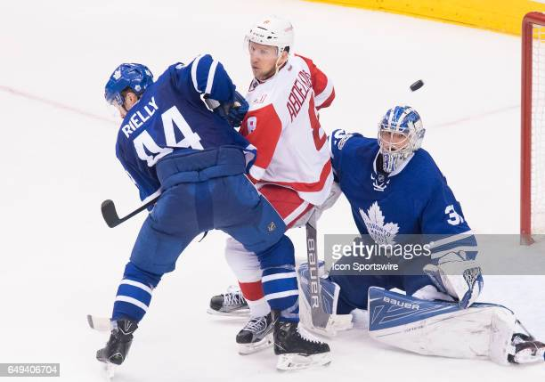 Detroit Red Wings left wing Justin Abdelkader battles for a puck with Toronto Maple Leafs defenseman Morgan Rielly in front of Toronto Maple Leafs...