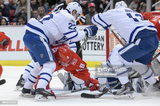 Detroit Red Wings left wing Justin Abdelkader gets caught under this scrum of players with Toronto Maple Leafs defenseman Nikita Zaitsev during the...