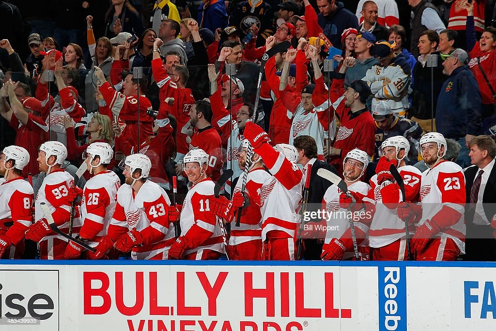 Detroit Red Wings players and their visiting fans celebrate an empty net goal against the Buffalo Sabres on April 8, 2014 at the First Niagara Center in Buffalo, New York. Detroit won 4-2.