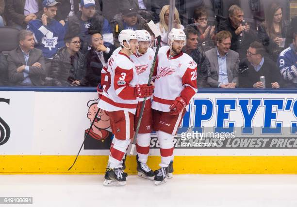 Detroit Red Wings right wing Gustav Nyquist celebrates a goal with Detroit Red Wings defenseman Nick Jensen and Detroit Red Wings defenseman Mike...