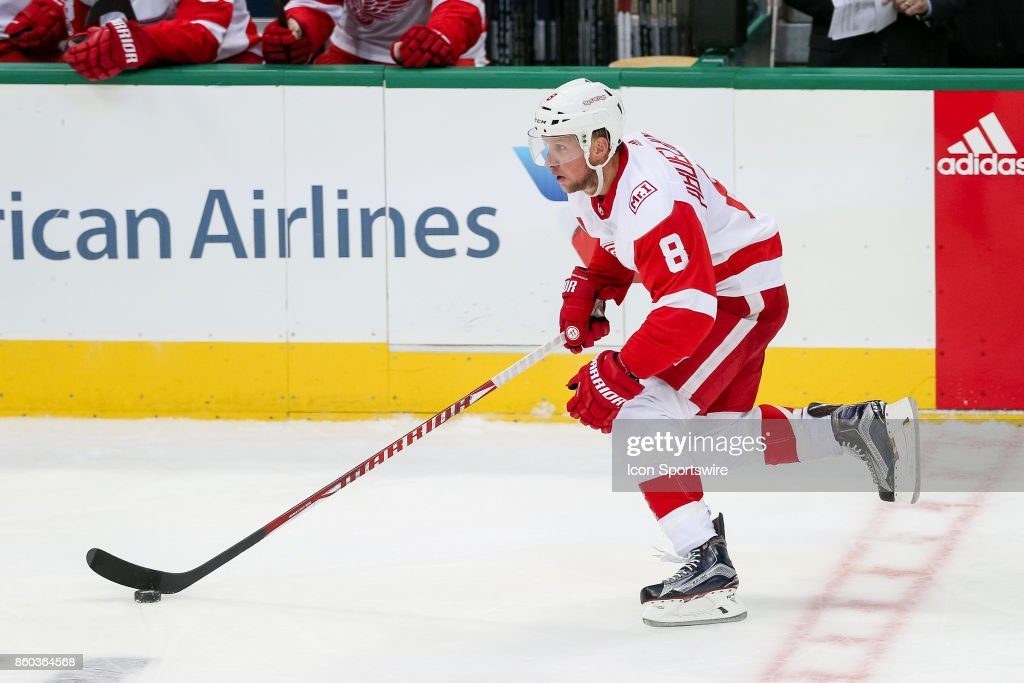 Detroit Red Wings Right Wing Justin Abdelkader (8) brings the puck across the center line during the NHL game between the Detroit Red Wings and Dallas Stars on October 10, 2017 at the American Airlines Center in Dallas, TX.