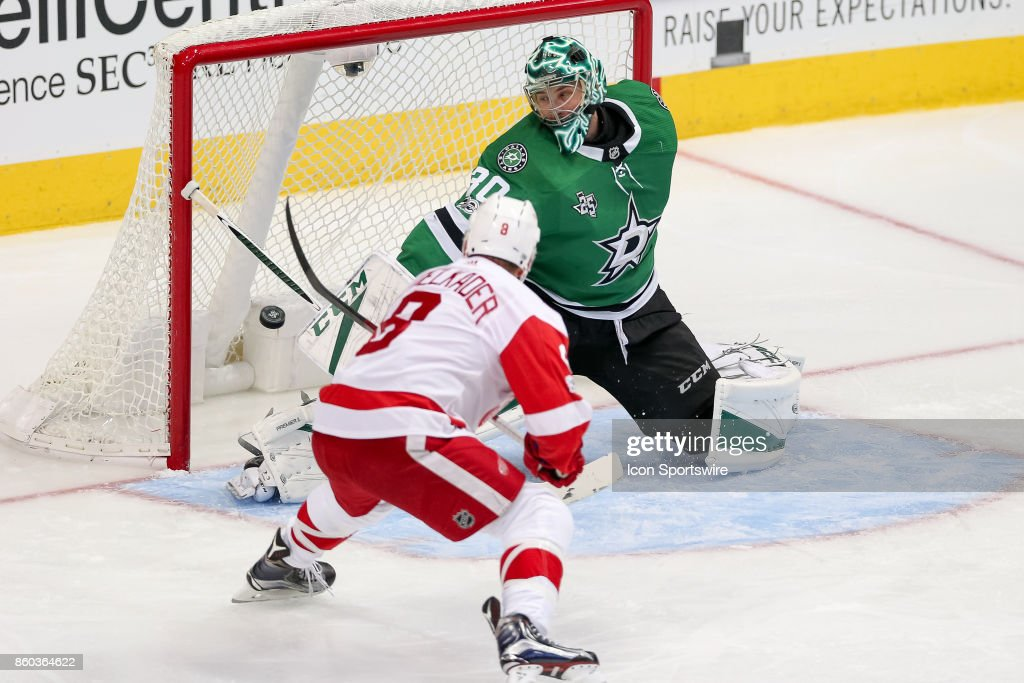 Detroit Red Wings Right Wing Justin Abdelkader (8) redirects a puck past Dallas Stars Goalie Ben Bishop (30) during the NHL game between the Detroit Red Wings and Dallas Stars on October 10, 2017 at the American Airlines Center in Dallas, TX.