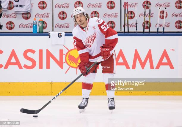 Detroit Red Wings right wing Mitch Callahan handles a puck during the warm up before a game against the Toronto Maple Leafs at Air Canada Centre in...