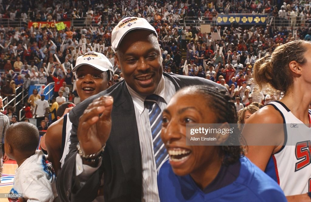 Detroit Shock Assistant Coach Rick Mahorn and Angelina Williams give each other a high five following the teams 8075 victory against the Sacramento...