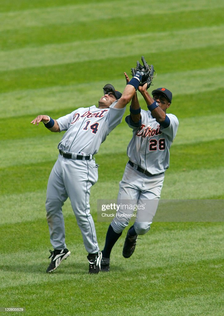 Detroit Tigers' 2nd Baseman Placido Polanco and Center Fielder Curtis Granderson almost collide during the game against the Chicago White Sox August...