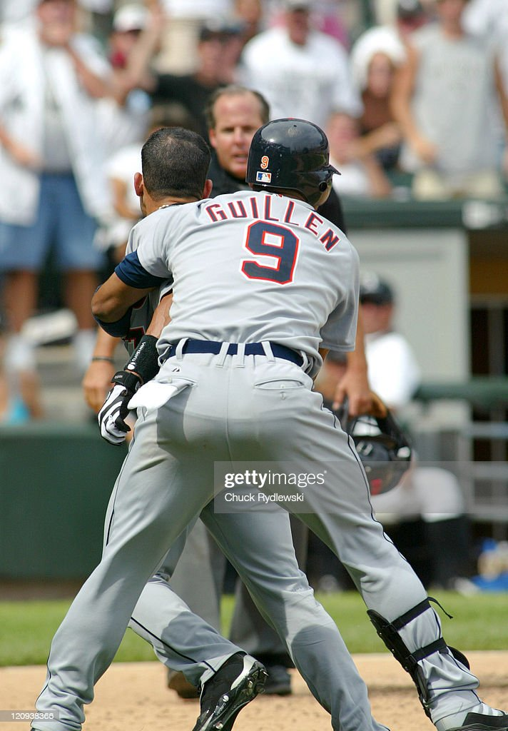 Detroit Tigers' Catcher, Ivan ' Pudge ' Rodriguez, has to be restrained by teammate, Carlos Guillen, after being thrown out of the game by home plate umpire, Tim Timmons, during their game against the Chicago White Sox August 13, 2006 at U.S. Cellular Field in Chicago, Illinois. The Tigers were defeated by the White Sox 7-3 and were swept in their 3-game series.