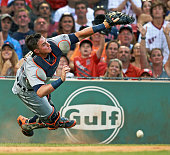 Detroit Tigers catcher James McCann miss a pop up hit by Boston Red Sox designated hitter David Ortiz in the bottom of the second inning at Fenway...