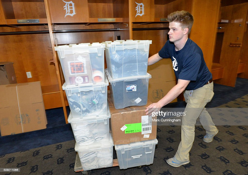 A Detroit Tigers clubhouse worker pushes a cart with items to be shipped on the truck headed to the Tigers Spring Training facility in Lakeland, Florida at Comerica Park on February 9, 2016 in Detroit, Michigan.