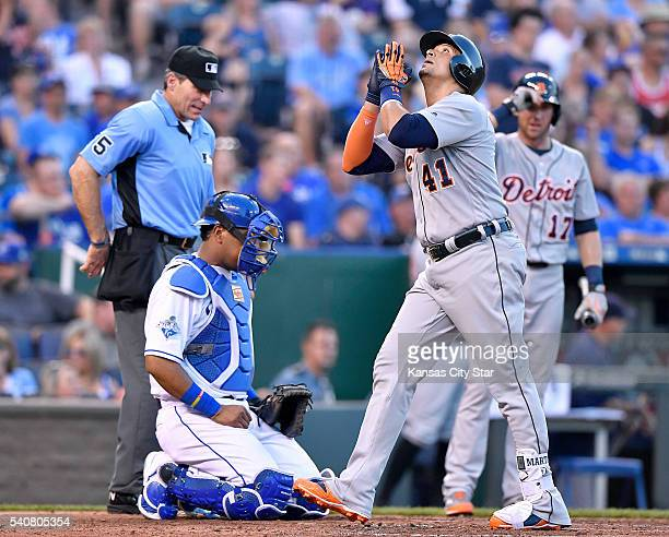 Detroit Tigers designated hitter Victor Martinez celebrates his second home run of the game in front of Kansas City Royals catcher Salvador Perez in...