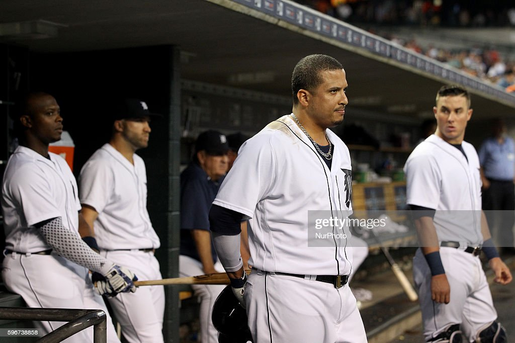 Detroit Tigers designated hitter Victor Martinez looks at umpire Mike Everitt from the dugout after his ejection during the third inning of a...