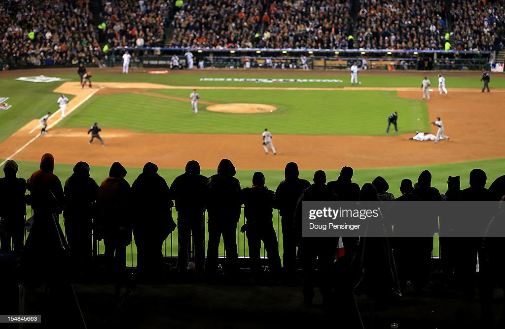 Detroit Tigers fans cheer during Game Three of the Major League Baseball World Series between the San Francisco Giants and the Detroit Tigers at Comerica Park on October 27, 2012 in Detroit, Michigan.