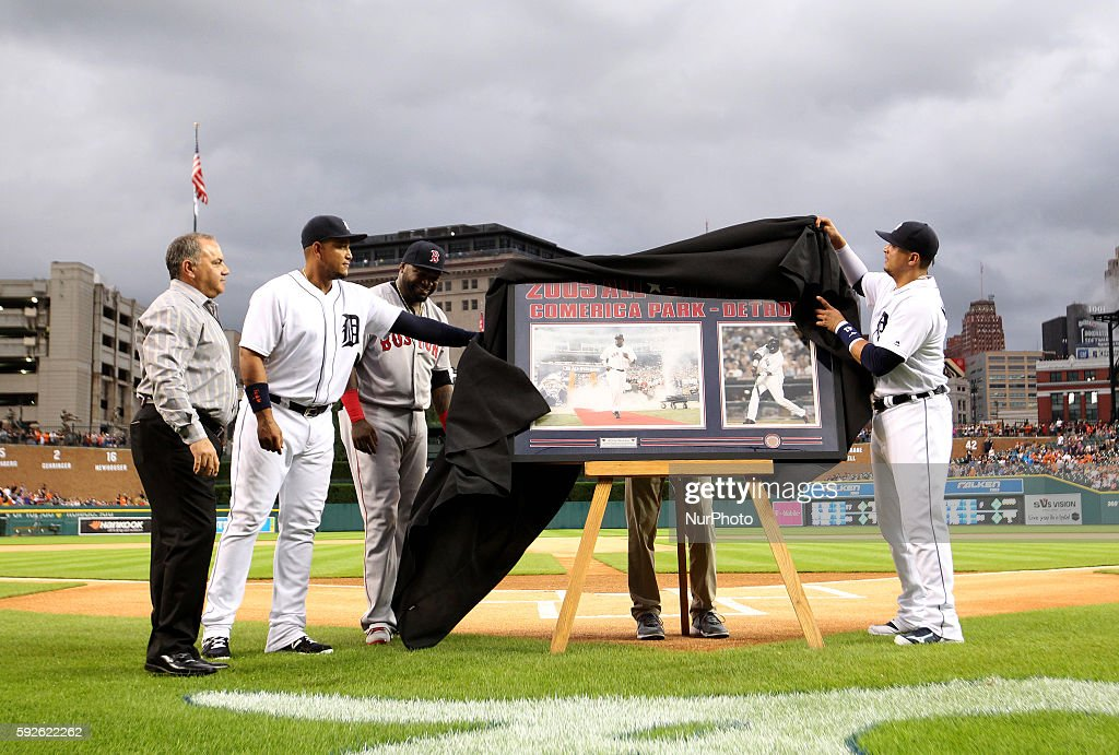 Detroit Tigers first baseman Miguel Cabrera left and designated hitter Victor Martinez unveil a gift of framed photos during a pregame ceremony in...