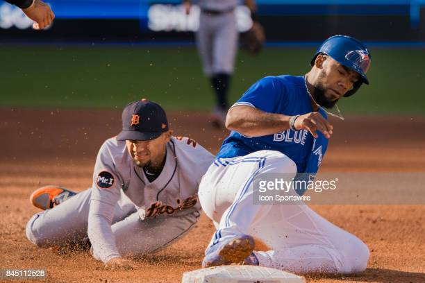 Detroit Tigers Infielder Dixon Machado dives and tags out Toronto Blue Jays Outfielder Teoscar Hernandez in a rundown between first and second during...